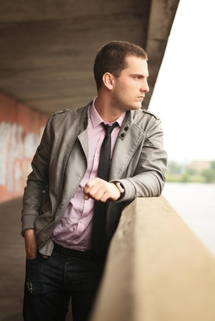handhold: young man standing near handhold Stock Photo