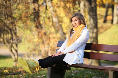 warmly: warmly dressed young woman in park