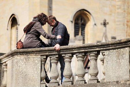 two women hugging: young woman calming her boyfriend  Stock Photo