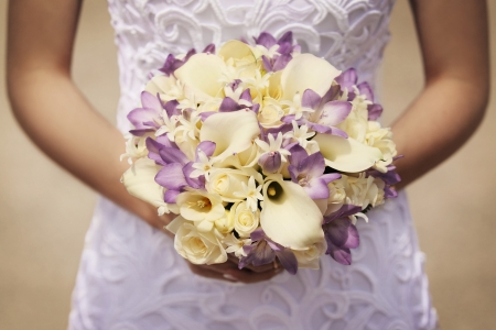 wedding reception: yellow and purple bride Stock Photo