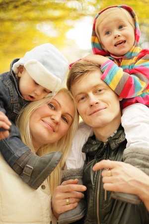 young happy family in the park Standard-Bild