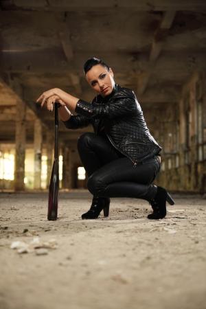 destroy: hooligan girl in old forsaken factory Stock Photo