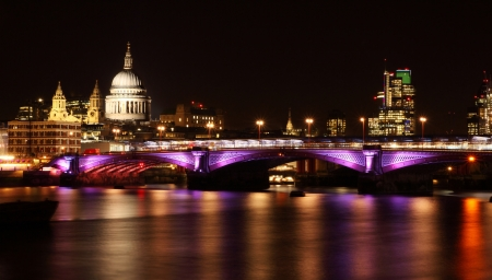 illuminated Blackfriars bridge in London at night