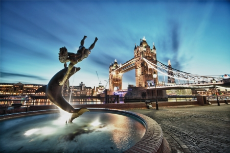 local landmark: Tower Bridge and St Katharine Docks Girl with a dolpin fountain Stock Photo