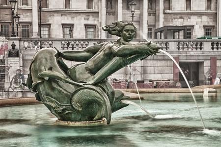 green bronze fountain on Trafalgar square Standard-Bild