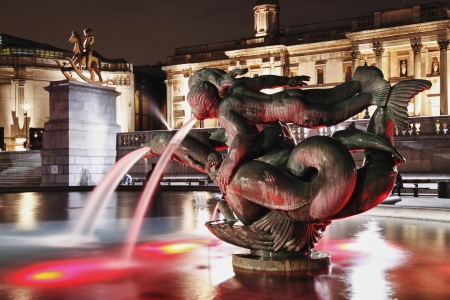 fountain with mermaids and fish on Trafalgar square at night