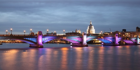southwark: southwark bridge illuminated in the evening