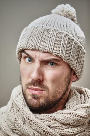 suspicious: suspicious man wearing warm winter clothes in studio