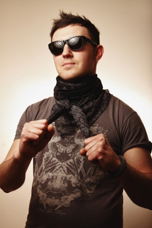 young mod in sunglasses posing in studio