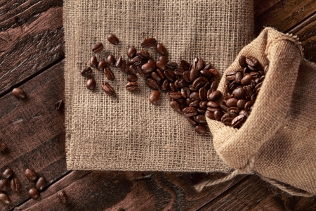 scattered on the burlap bag of coffee