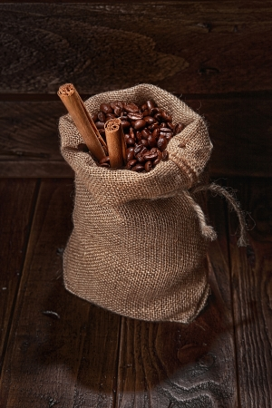 small bag of coffee beans and stick of cinamon