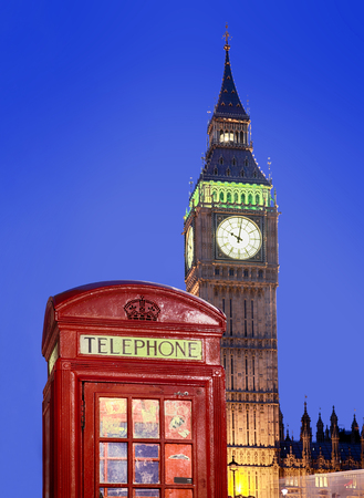 classic red K6 phone box against Big Ben at 10 in the evening