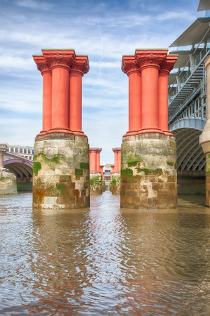 Pillars of the old derelict LB&SCR elegant railway bridge designed by Robert Mylne%u2019s in 1769 and removed in 1985 at Blackfriars.