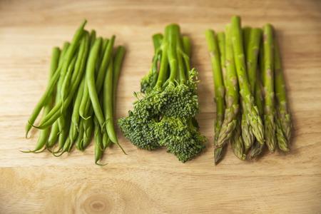 antioxidants: healthy green vegetables on wooden chopping board