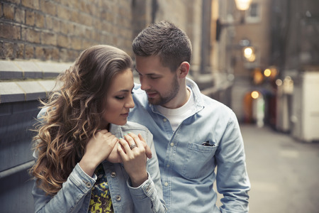 20 29 years: handsome young man hugging beautiful woman on street