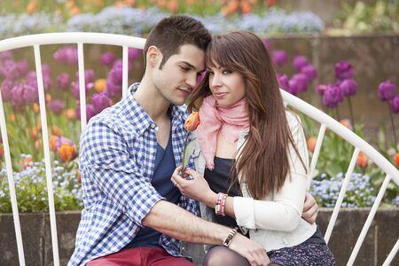 young handsome man hugging his girlfriend in park Standard-Bild