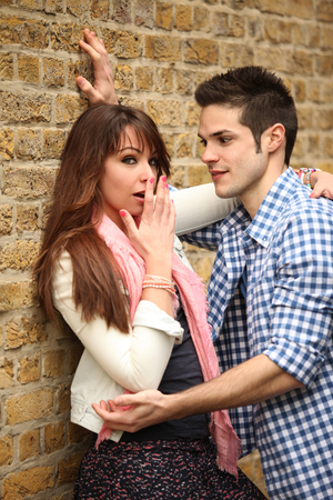 fart: young couple outdoors in inconvenient situation Stock Photo