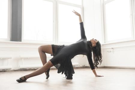 jazz modern: young dancer having rehearsal in studio
