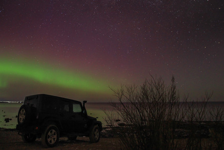 magnetic stones: Leningrad Oblast, Russia, February 16, 2016. Jeep Wrangler on the shore of Lake Ladoga, the Jeep Wrangler is a compact four wheel drive off road and sport utility vehicle