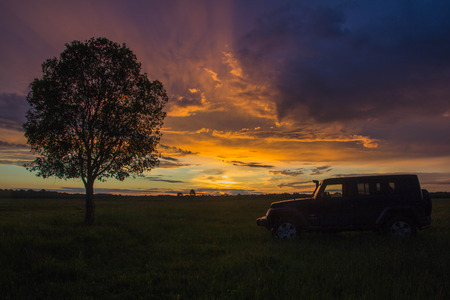 off road: Novgorod oblast, Russia, August 03, 2015, Jeep Wrangler on a rural road in the Novgorod region, the Jeep Wrangler is a compact four wheel drive off road and sport utility vehicle