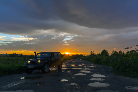 Novgorod oblast, Russia, August 03, 2015, Jeep Wrangler on a rural road in the Novgorod region, the Jeep Wrangler is a compact four wheel drive off road and sport utility vehicle