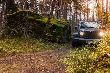 Leningrad Oblast, Russia, 15 October 2014. Jeep Wrangler in the Karelian woods, the Jeep Wrangler is a compact four wheel drive off road and sport utility vehicle