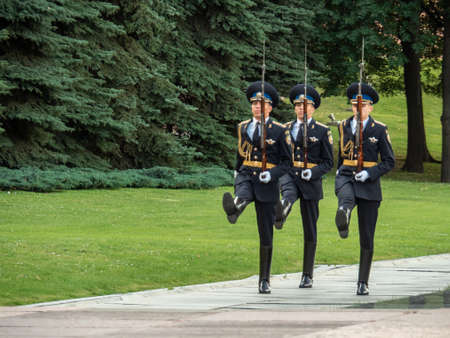 MOSCOW, RUSSIA - ?????? 03, 2019: Hourly change of the Presidential guard of Russia at the Tomb of Unknown soldier and Eternal flame in Alexander garden near Kremlin wall Editorial