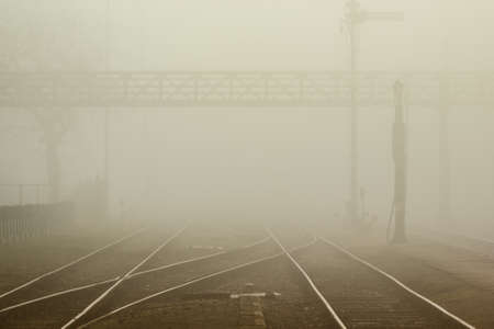 conveyor rail: Trainstation in fog Stock Photo