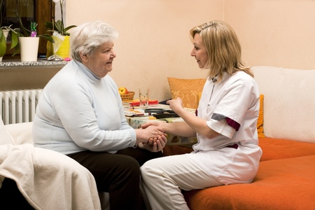 nursing staff: home visit nurse with senior