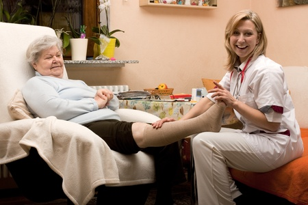 wounds: home visit nurse with senior