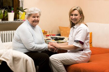 home visit nurse with senior Stock Photo - 12627212