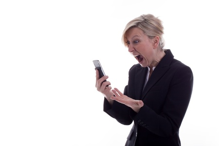 disappoint: businesswoman with handy is screaming