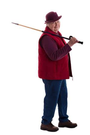 A walking female senior looks to viewer 3 photo