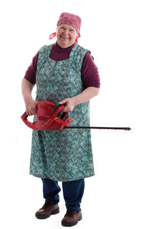 A lusty female senior with garden saw  looks to viewer photo