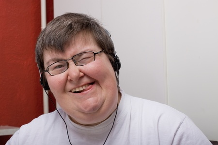 a sitting mentally disabled woman is listening to music Stock Photo - 12900854
