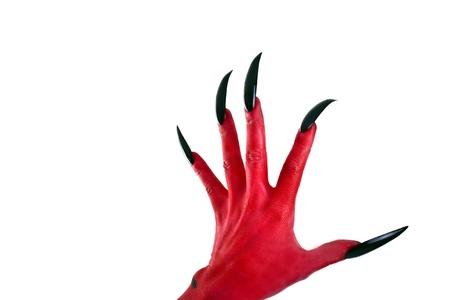 a red devil Hand mit schwarzen Nägeln