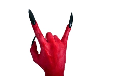 a red devil hand with black nails photo
