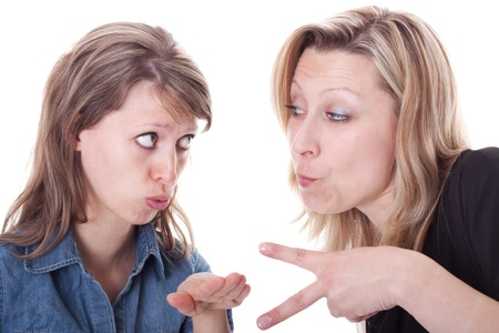 a blonde and a brunette young woman are playing a game Stock Photo - 13048097