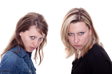 two beautiful young angry woman looking to the viewer photo
