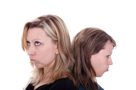 a blonde and a brunette pouting young woman Stock Photo - 13078435