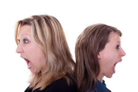 two pretty woman are screaming in different directions photo