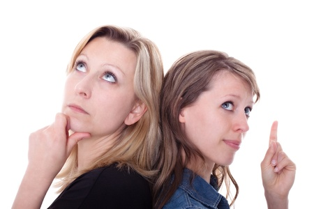 two beautiful young woman thinking, one of them have a idea Stock Photo - 13078439