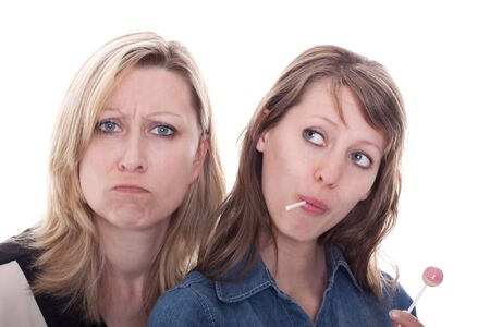a brunette woman with lolly and a blond woman without any sweets Stock Photo - 13078436