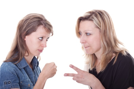 two young woman are looking to each other and playing a game Stock Photo - 13078441