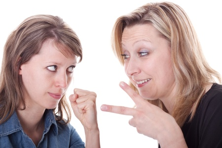 a blonde and a brunette young woman playing a game Stock Photo - 13078446