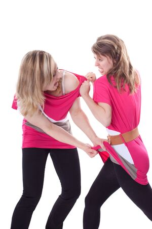two beautiful young woman are fighting because of a dress Stock Photo - 13078432
