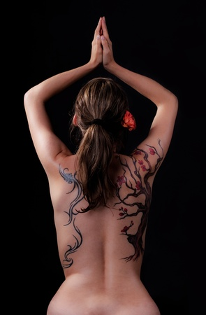 pretty young girl with a lot tattoos on her back Stock Photo