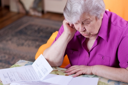 Pensioner read countless papers and is very focused photo