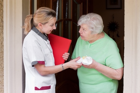 nurse greeted with her patient Stock Photo