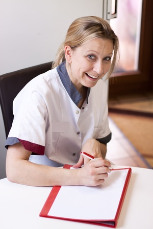 recorded: Geriatric nurse makes a home visit and recorded the data of a patient Stock Photo